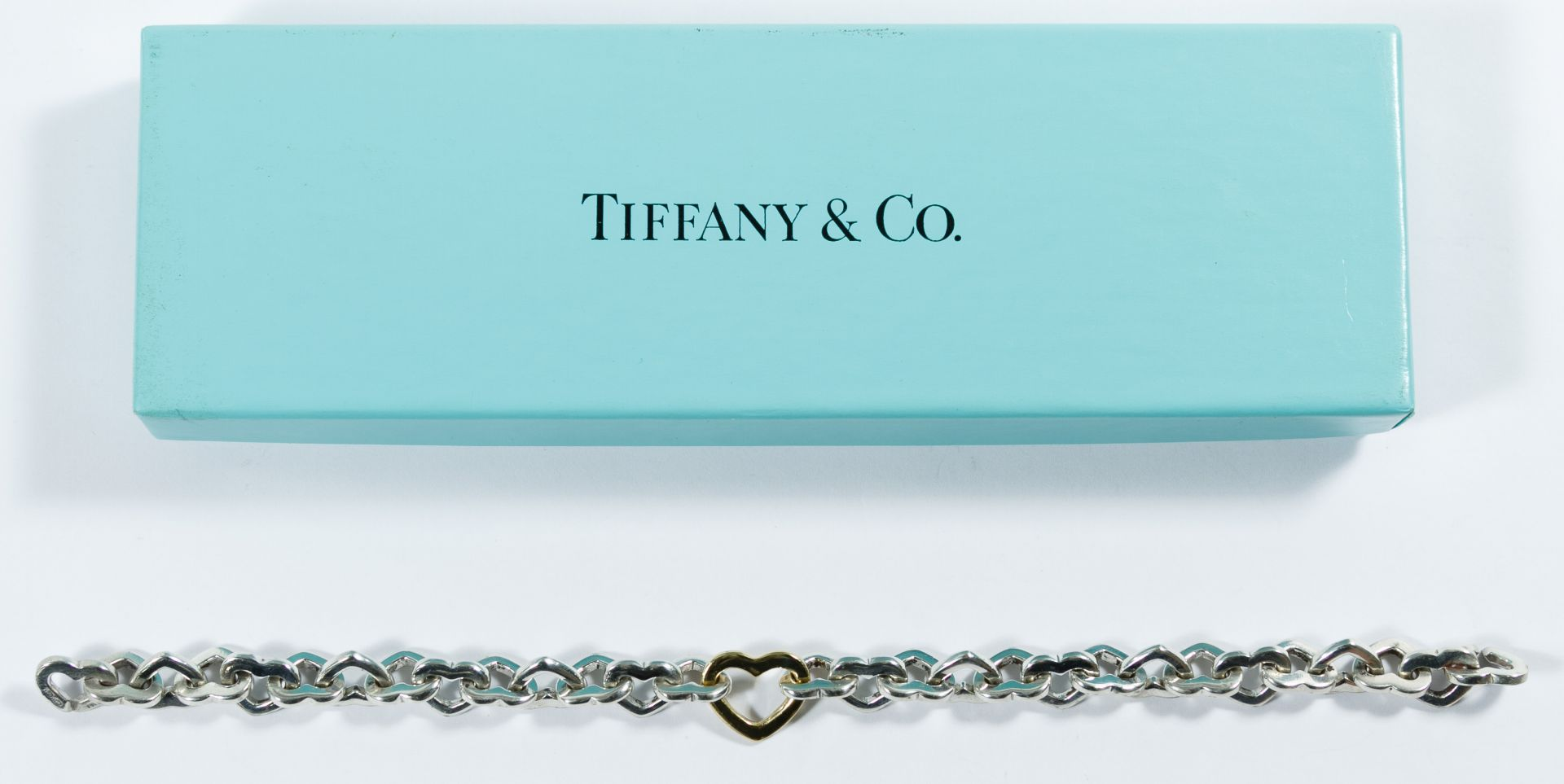 66ddb853013 Lot 267: Tiffany & Co. Sterling Silver and 18k Gold Heart Link ...