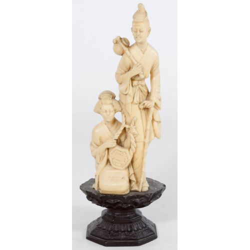 Carved Man and Woman Oriental Figurine